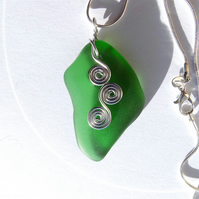 Sea tumbled glass pendant, on snake chain, pale emerald green.