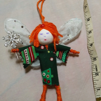 Orange (ginger) and green bendy tree fairy