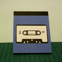 Cassette notepad and pin badges set.