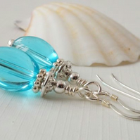 Aqua blue glass and silver earrings.
