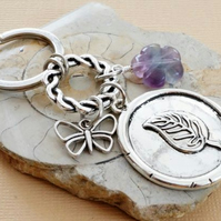 Carved purple fluorite flower, wax seal leaf and butterfly keyring.