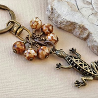 Gemstone keyring with fire agate and an antique bronze lizard or gecko charm.