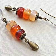 Shades of orange gemstone earrings with carnelian and antique bronze.