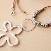 Long boho style leather necklace with silver flower pendant