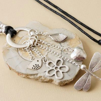 Long adjustable length necklace with dragonfly leaf flower bird heart charms