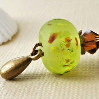 Lime green blossom lampwork bead and Swarovski crystal antique bronze keyring