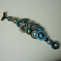 Teal temptation brick stitch beadwork bracelet
