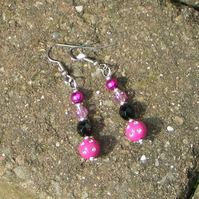 Hot pink and black dangly pierced earrings