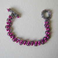 Hot pink and gunmetal Beadwork bracelet