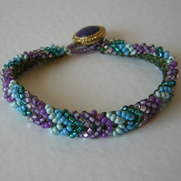 Purple and blue woven seed beads bracelet