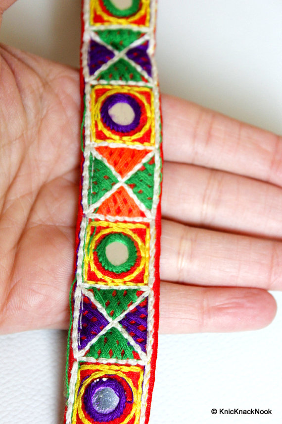 Red Mirrored Fabric Trim With Yellow, Green, Violet, White And Orange Threadwork