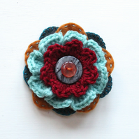 Colourful crochet flower brooch: deep red, seafoam green, copper
