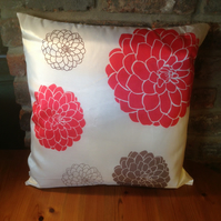 Large cream cushion with brown and orange printed flowers