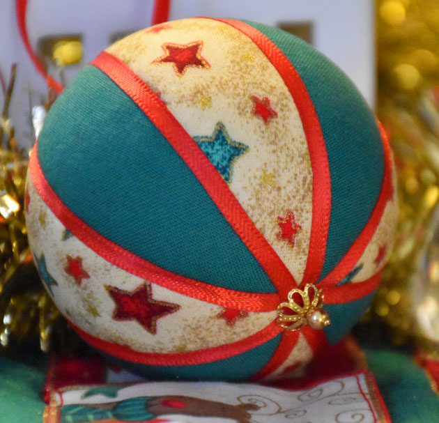 Christmas Bauble hanging decoration with star design in red, green and gold