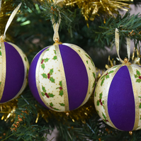 Christmas Bauble hanging decoration with holly design in purple and gold