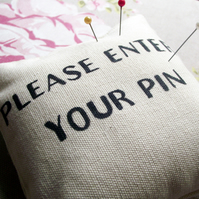 'PIN' cushion