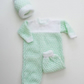 Hand knitted romper suit