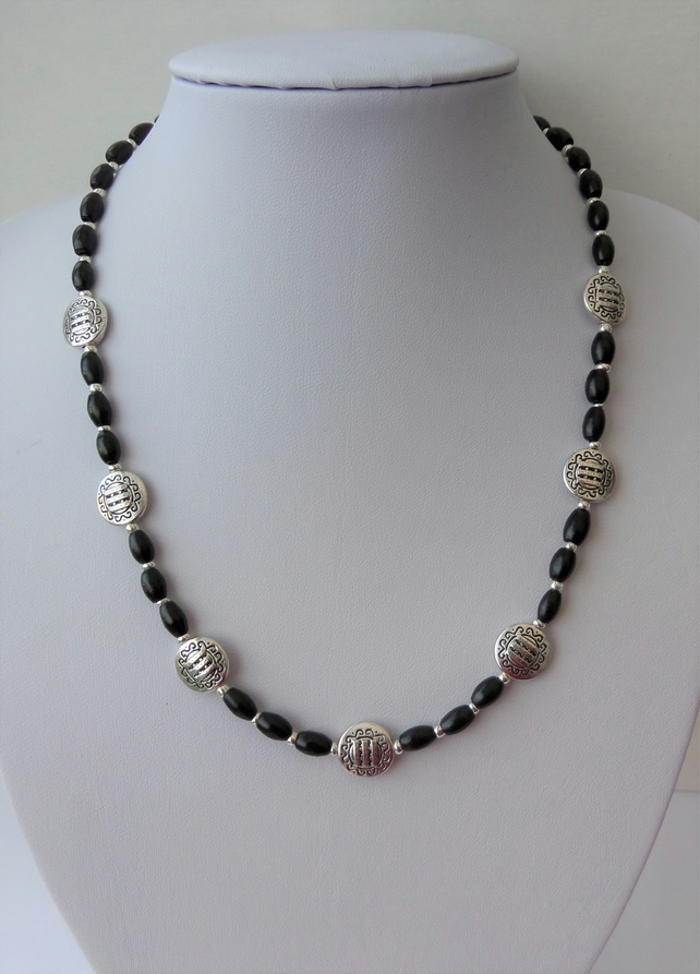 Tibetan silver and black wood necklace.