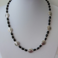 Tibetan silver and dyed black wood necklace.