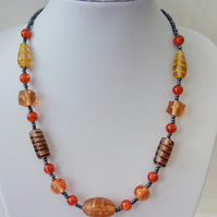 Orange crackle and lampwork cream beige tones glass bead necklace. Gift or treat