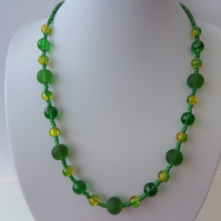 Reduced. Mixed green bead necklace with a hint of yellow
