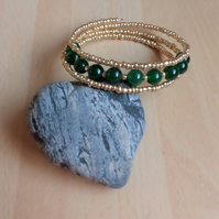 Gold and green gemstone memory wire wrap bracelet.