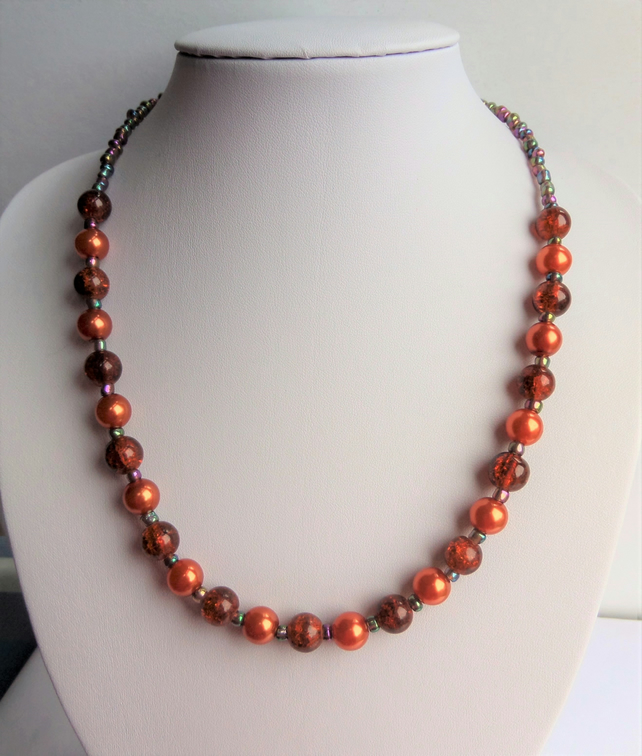 Orange glass bead and metallic rainbow seed bead necklace