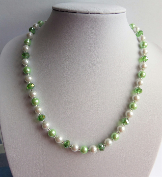 Green rondelle and light green and white glass pearl bead necklace.