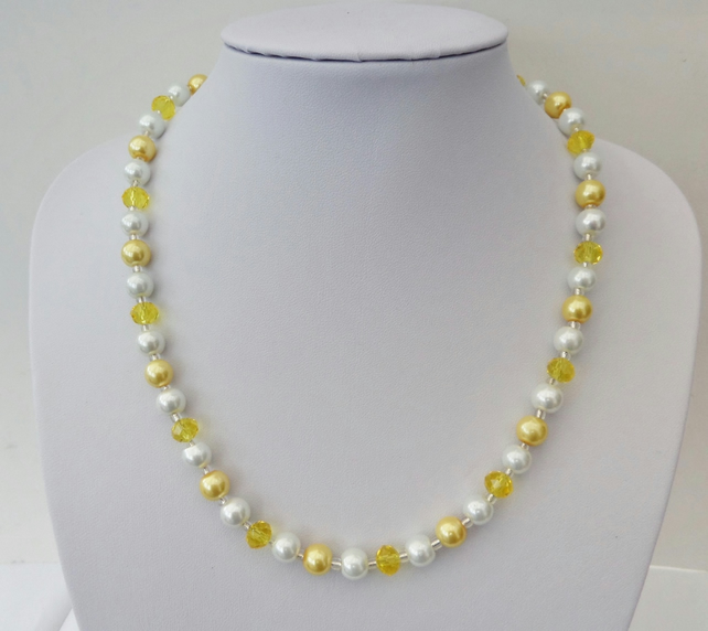 Yellow rondelle and yellow and white glass pearl bead necklace.