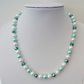 Peacock green rondelle and light blue and white glass pearl bead necklace.
