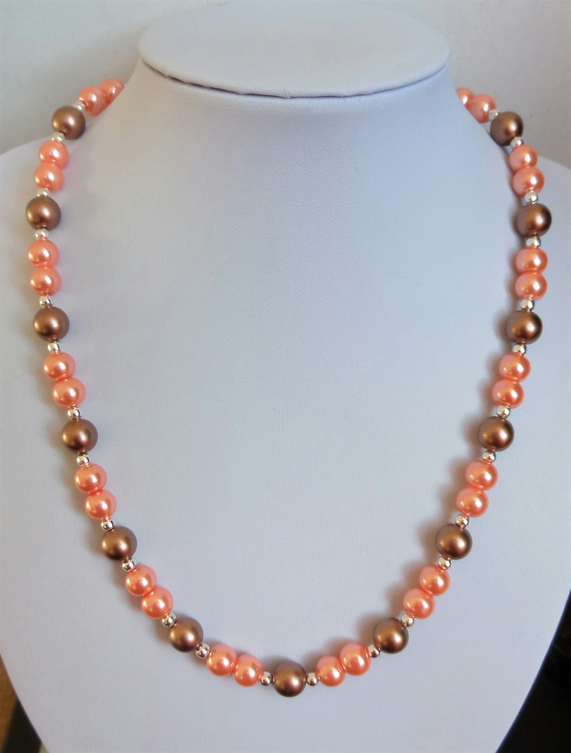 Peach and brown-bronze faux pearl bead necklace.