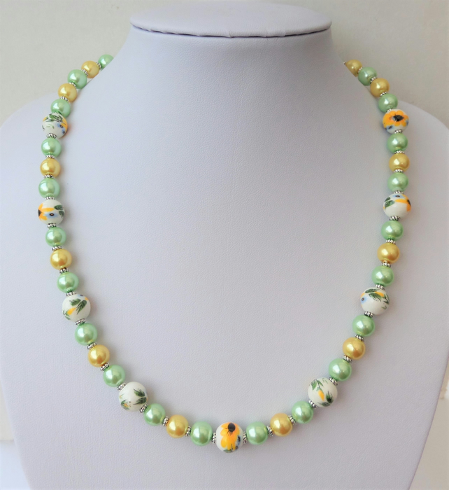 Yellow and green ceramic and glass pearl bead necklace.
