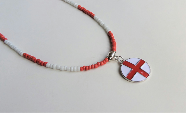 Red and white seed bead necklace, enamelled charm.