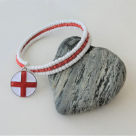 Red & white seed bead memory wire bracelet, enamelled charm.