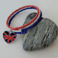 Red, white and blue seed bead memory wire bracelet, enamelled heart charm.
