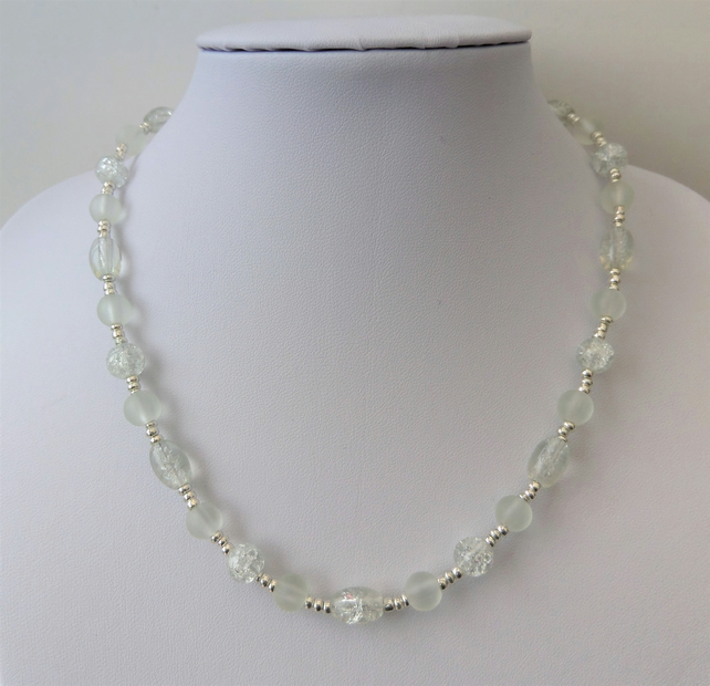 Sale price reduced. Clear glass bead necklace, frosted and crackle beads.