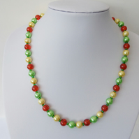 Orange, yellow and green glass pearl and crackle bead necklace.