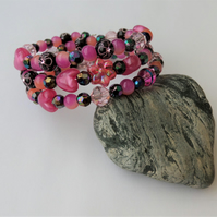 Black, dark purple and shades of pink memory wire wrap bracelet