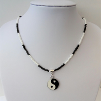 Black and white seed bead necklace, enamelled yin yang charm.