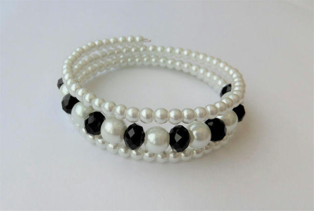 Black crystal and white glass pearl memory wire wrap bracelet