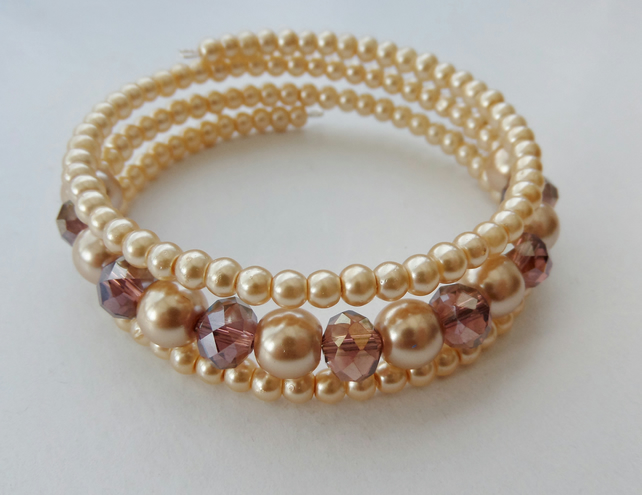 Light purple AB crystal rondelle and pale gold glass pearl memory wire bracelet.