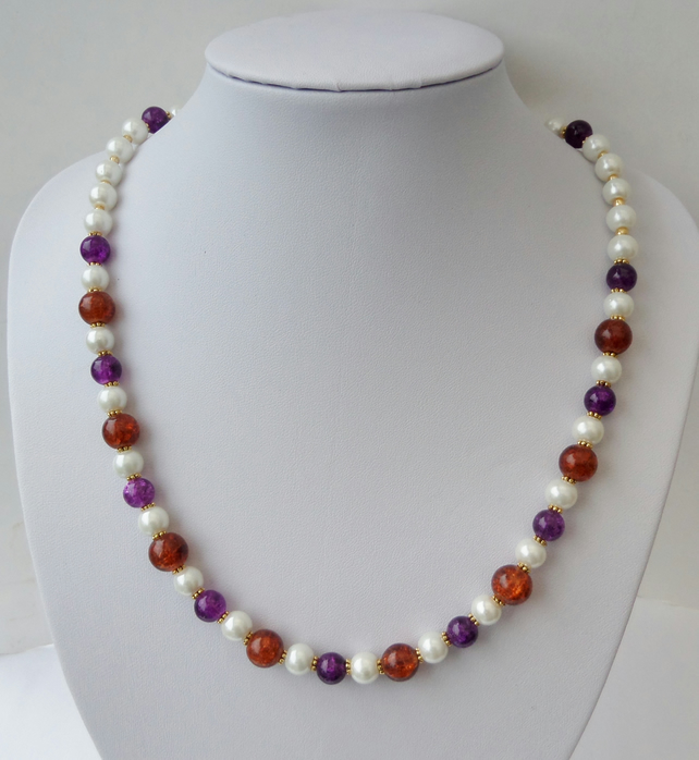 Cream pearl, purple and dark orange crackle bead necklace.