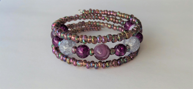Clear and purple and metallic seed bead memory wire wrap bracelet.