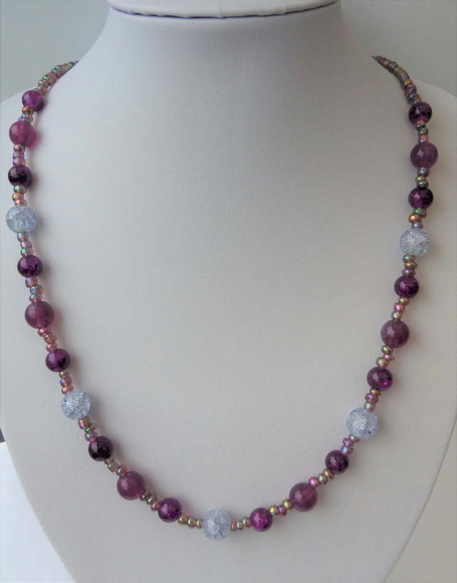 Clear and purple and rainbow metallic seed bead necklace.