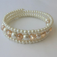 Champagne crystal rondelle and cream glass pearl memory wire bracelet.