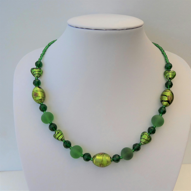Green oval and heart foiled, round frosted and faceted glass bead necklace.