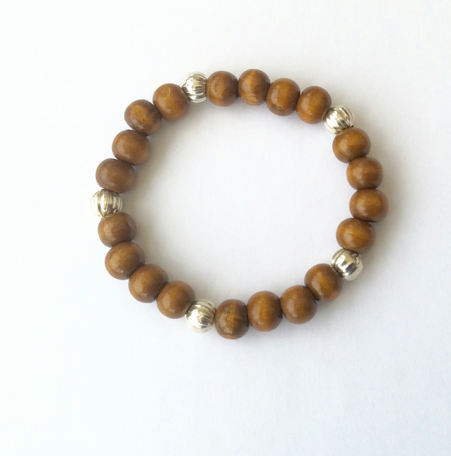 Brown wooden bracelet with Tibetan silver melon spacer beads