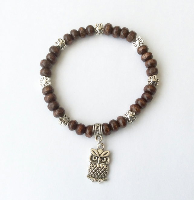 Dark brown wood bracelet, Tibetan silver flower spacer beads and an owl charm