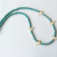 Necklace with mother of pearl bird beads with turquoise coloured beads