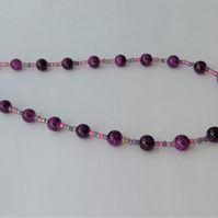 Purple glass bead necklace